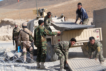 Afghan soldiers unload new HESCO protection walls which delivered Czech soldiers