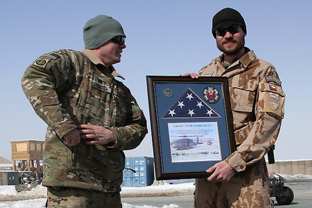 Staff Sergeant Michal Novotny with the BSM certificate