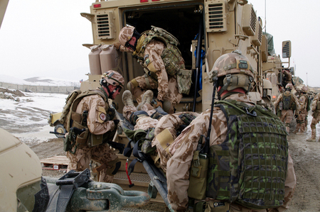 Practice in loading of the wounded into MRAP vehicle