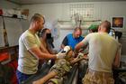 Medics cooperate in saving life of a soldier