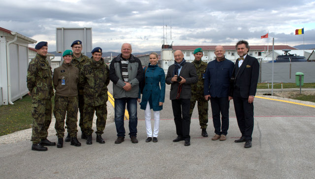 Deputies with soldiers at the Pristina base