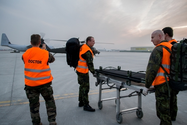 Personnel are ready to receive a patient from a heliport