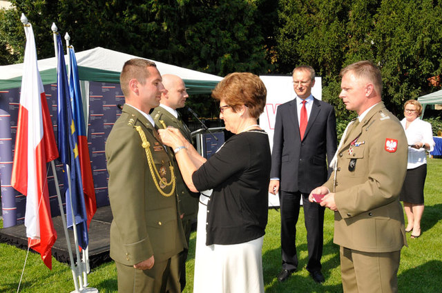 Czech officers receiving the Star of Afghanistan from Grazyna Bernatowicz, Polish Ambassador to the Czech Republic, and Colonel Jacek Stec, Polish Defence Attaché