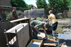 Soldiers remove soaked furniture and home material