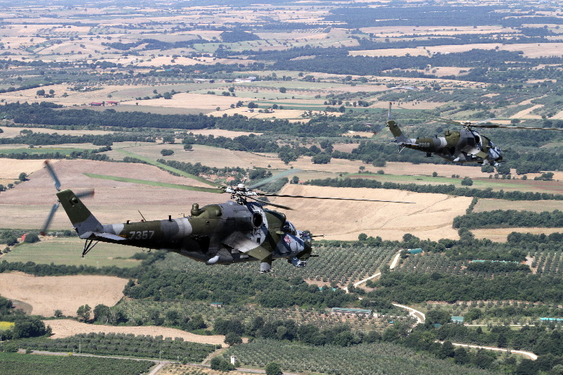 A flight of Czech Mil Mi-24V helicopters over Italian landscape