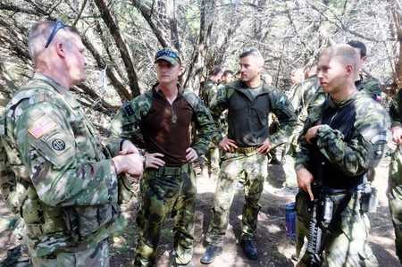 An American commander instructing Czech soldiers