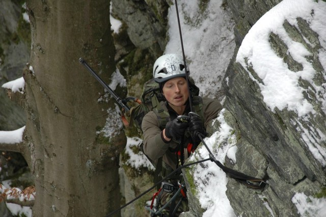 Climbing with a machine gun up a 30-metre high rock