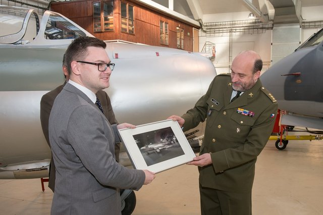 Director of the Military History Institute, Colonel Ales Knizek, receiving a commemorative photo of the aircraft