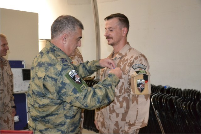 Commander of 19th AAT receiving the NATO Commemorative Medal
