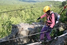 "Getting over a ravine on the so called ""Burma bridge"" requires bravery and exact movement coordination"