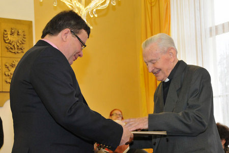 Minister Alexandr Vondra hands over the certificate to Father Frantisek Pevny for his active cooperation with a resistance group at the Jihlava region