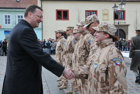 Petr Necas congratulates to one of awarded soldiers