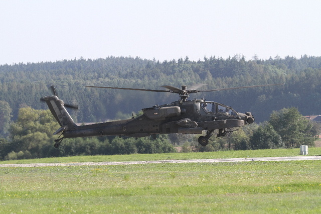 American combat helicopter AH-64 Apache takes off