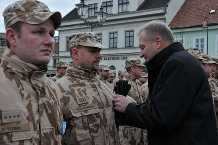 Deputy Vlastimil Picek hands over medals for service to soldiers