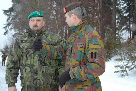 Czech liaison officer Captain Jaroslav Tuma talks with chief of operations group of Belgian soldiers