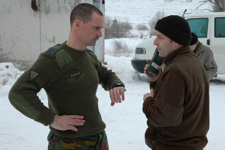 Czech First Lieutenant Jaroslav Pekarek (right) informs Belgian soldier about close air support by L-159 ALCA aircraft procedure