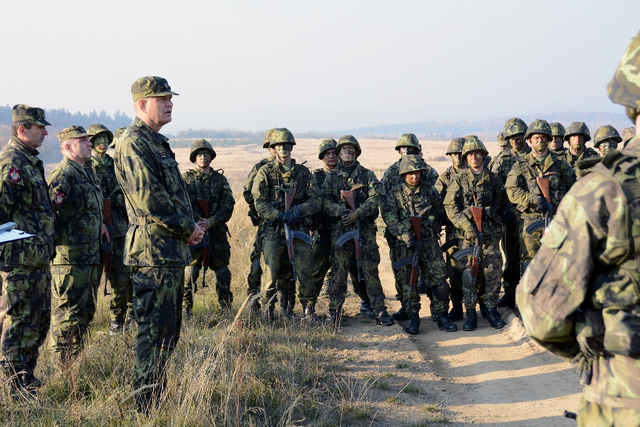 General Becvar in a discussion with military recruits during their tactical training at the Military Training Area in Brezina