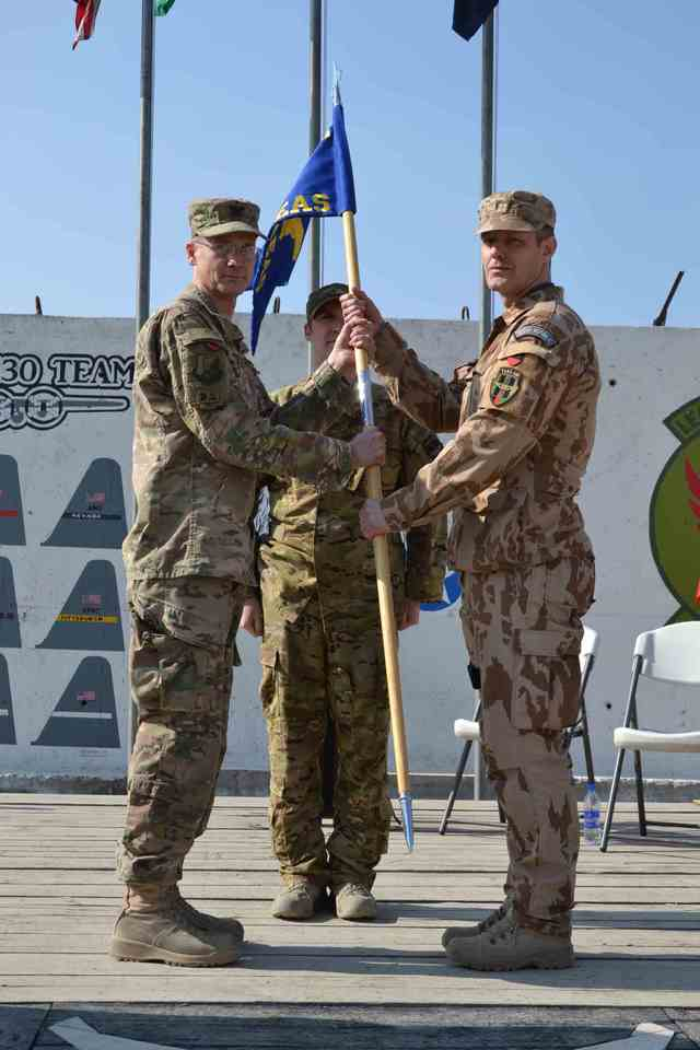 Major Radek M. taking over the flag of the 311th Air Expeditionary Advisory Squadron (former 438 AEAS)