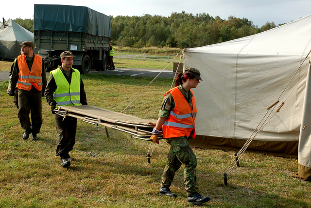 Installing 15 camp beds in each of the 30 accommodation tents