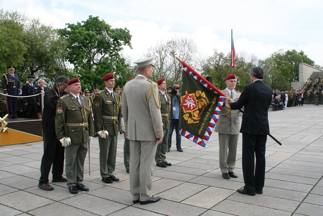 Minister of Defence Martin Stropnicky receiving the combat flag of the General Staff from outgoing General Pavel