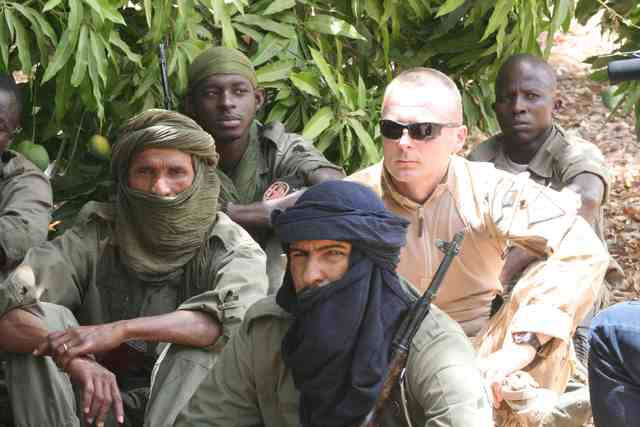A Czech instructor together with Malian soldiers listening to a lecture on human rights