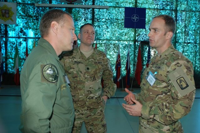 Major Pavel Prochazka discussing with his American colleagues