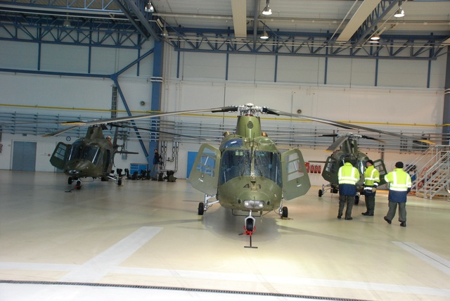 Due to unfavourable weather, helicopters were parked inside the air maintenance hall
