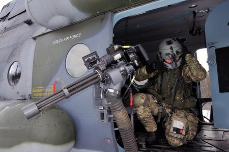 A door gunner with his M134D-H Minigun machine gun & Life-fire training exercise for helicopter door gunners | Ministry ...