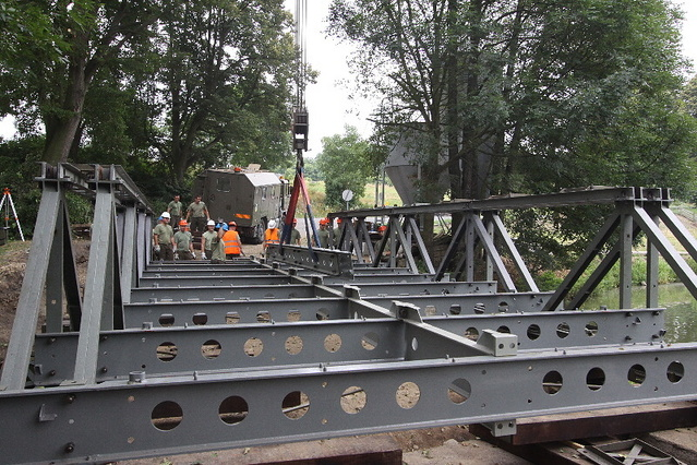 This is not an exercise = soldiers at Chlum u Sedlcan assemble the last of six temporary bridges in the aftermath of June floods