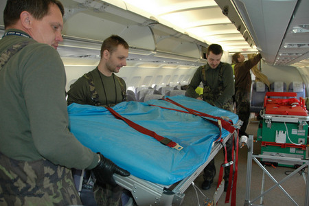 Technicians of the Kbely Airport Base attach upper part of a stretcher to the framing