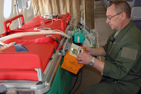 Bed is equipped with defibrillator, monitor of life functions and a breathing device