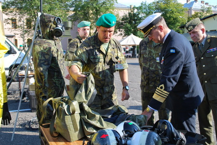 General examines chemical protection suits and gas masks