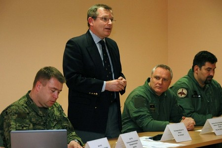 First Deputy Minister of Defence Jiri Sedivy (standing) and Brigadier General Bohuslav Dvorak (second from the right)