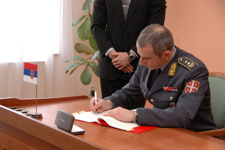 Capable Logistician 2013 planning: Serbian General Goran Radovanovic signing Czech-Serbian agreement in Prague (27 February 2012)