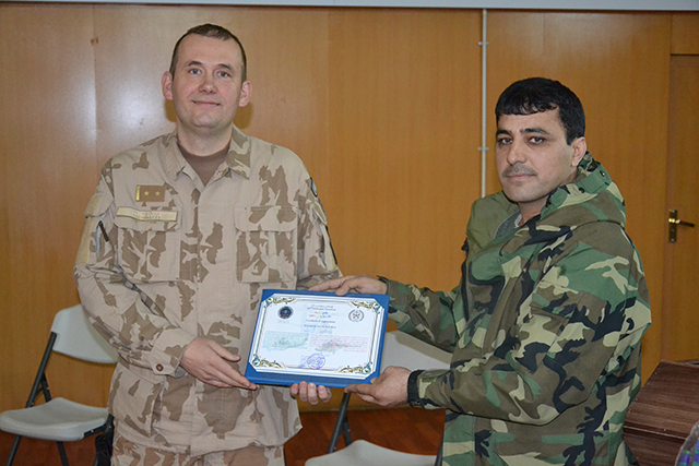 LTC Sliva being presented with a certificate from COL Samim Farid