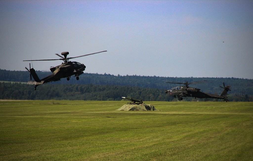 U.S. AH-64 Apache helicopters training in ground air defence
