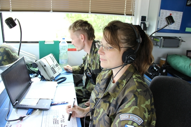 1stLT Eva Slovak Kubalova and CPT Kamil Stascik at a mobile Control and Reporting Centre during the homing of helicopters of the HELI UNIT for the close air support