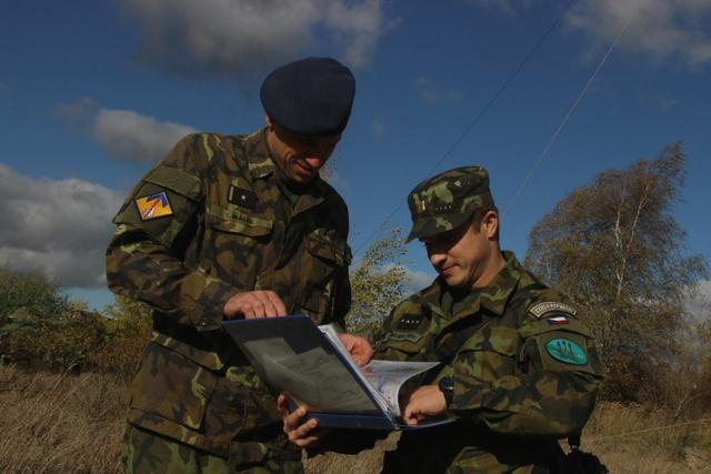 Major Lukas Malek and Captain Ludek Simanek supervising simulated combat activities