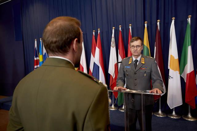 LTG Esa Pulkkinen, Director General of the EU Military Staff, presenting the medal to Corporal C. H.
