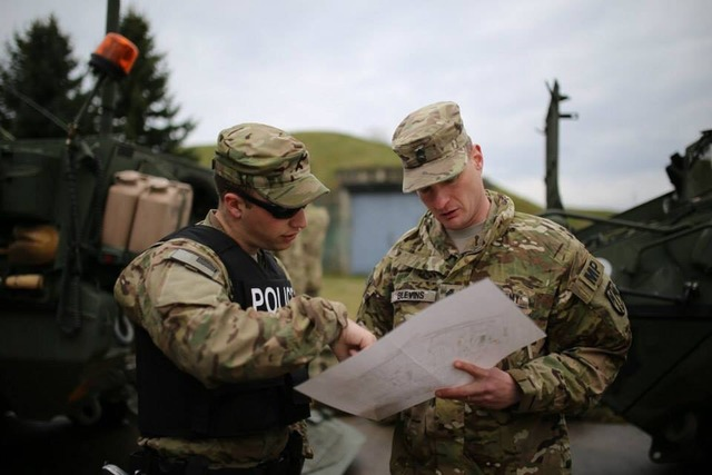 U.S. Military Policemen checking a map