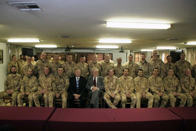 Family photo with soldiers of the Guard Company at Bagram
