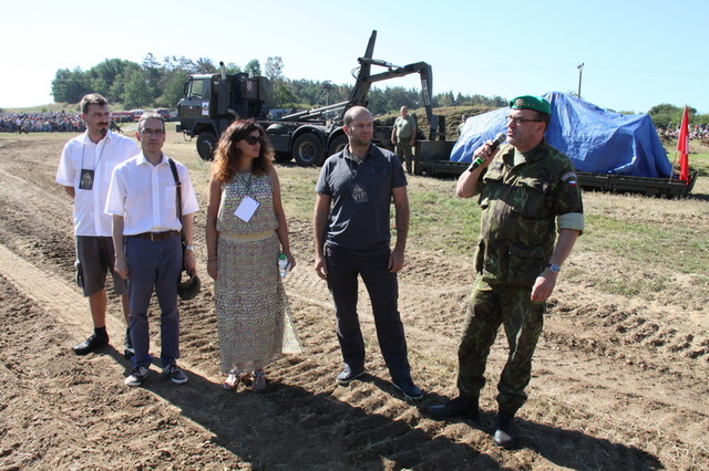 Demonstration of an LTH tank acquired from Switzerland.  From the right, Colonel Ales Knizek, Director of the Military History Institute, Pavel Beran, Deputy Defence Minister, Miroslava Pokorna-Jermanova, Deputy Chairman of the House of Deputies of Czech Parliament, and two Swiss guests: Werner Bardill and Pascal Mouther