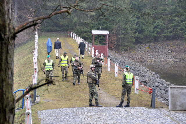 Soldiers' activities are evaluated by a staff of referees (in yellow vests)