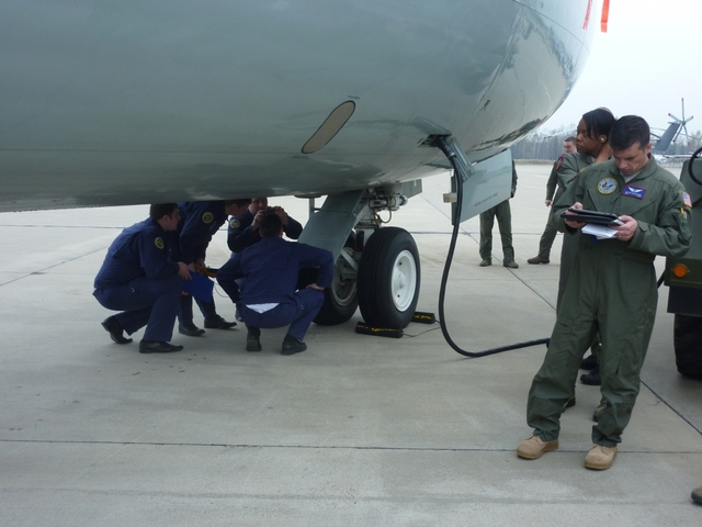 Czechs, Americans and Russians thoroughly checking the recording cameras and sensors before the flight