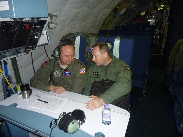 Commander of the team, LTC Christopher Johnson, and his deputy, LTC Vladimir Supsak, aboard OC-135B aircraft