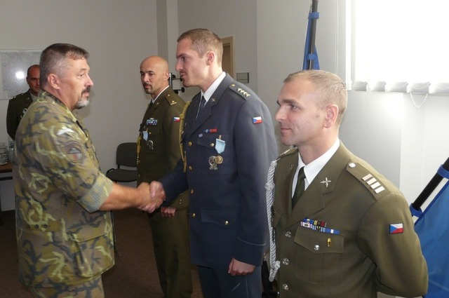 MG Opata hands over the Medal for Service Abroad