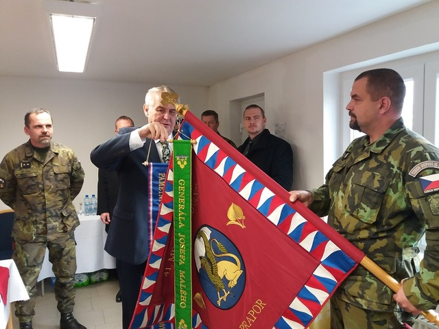 President Zeman attaching the Commemorative Ribbon to the flag of 41st Mechanised Battalion