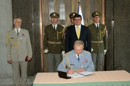 General Vlastimil Picek signs the change of command protocol