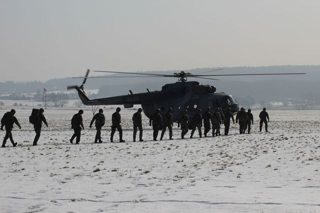 Soldiers getting in the helicopter