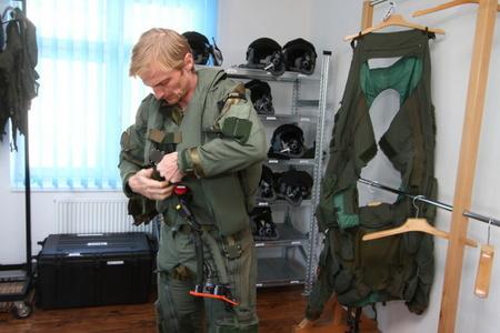 Pilot of JAS-39 Gripen puts on his flying suit